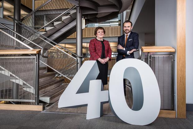 Happy Birthday: Marie McHugh of Ulster Business School joined Gerry Mallon, Danske Bank chief executive and chairman of alumni group yesterday, to celebrate the school's 40th anniversary