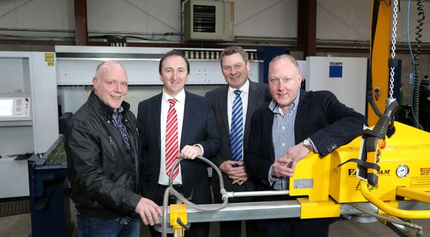 Cutting edge: Ian Dawson (left) and Colin Dawson (right), with Danny McGivern and Girvan Gault of Ulster Banking