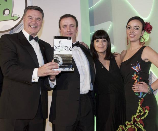 John Mulholland (second from left) receives his award from Skoda's Alasdair Stewart and television personality Claudia Winkleman (second right)