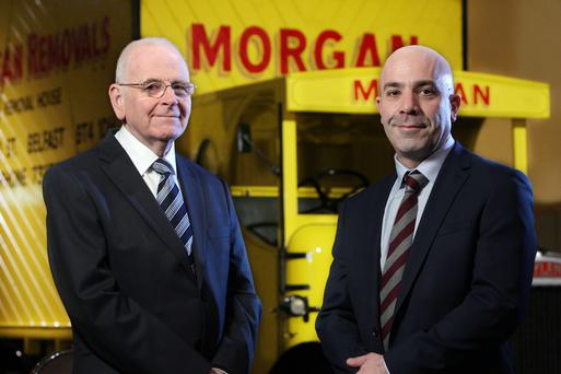 Raymond Morgan, group chairman of John Morgan & Sons – and grandson of the founder — and David Dunlop, company director and great grandson of the founder, are celebrating the firm's 100 years in business