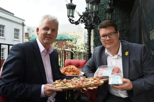 Paddy Doody, sales and marketing director at Henderson Wholesale, and Neal Kelly, fresh foods director at the Henderson Group, officially launch the new Spar own brand label, 'enjoy local'