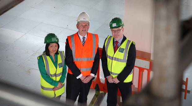 Belfast Harbour property director Graeme Johnston with GRAHAM bids manager Jenny Wong and Graham's Mark Gibson