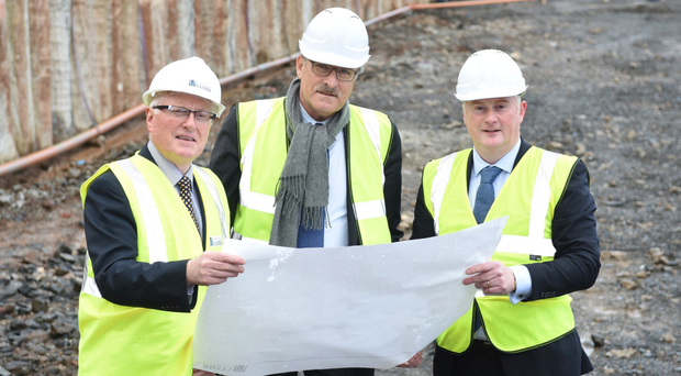 Looking at plans for the build are , from left, Ulster University acting vice-chancellor, Professor Alastair Adair; Rui Vieira de Sa, president of Somague and Colin Loughran, CEO Lagan Construction