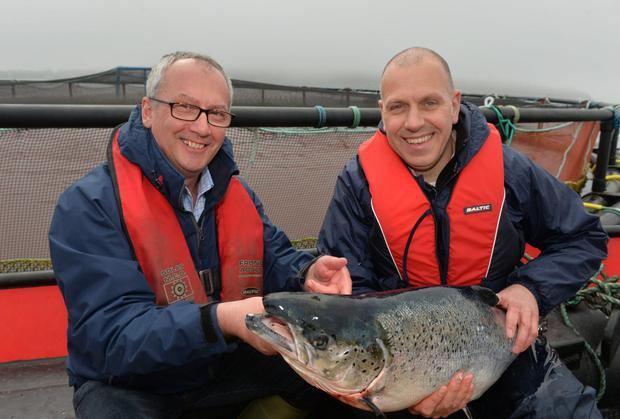John Russell of Glenarm Organic Salmon and John Hood, Invest NI which has provided support to help the business to expand