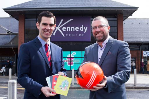 Ryan Kee, director of retail agency at Lambert Smith Hampton, and John Jones, centre manager for the Kennedy Centre, celebrate the centre's latest two tenants, Card Factory and JD Sports