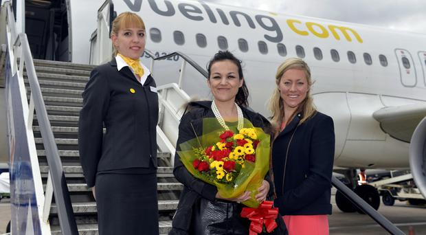 Susana Veloso, the first passenger on the new flight to Barcelona, with a Vueling crew member, were welcomed by Katy Best, commercial and marketing director at Belfast City Airport