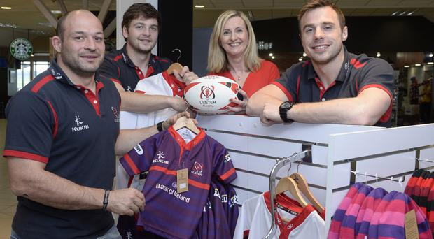 Ulster Rugby stars Rory Best, Iain Henderson and Tommy Bowe with Michele Hunter, manager at Aelia Duty Free