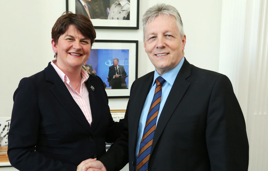 Arlene Foster is congratulated on her move by Peter Robinson