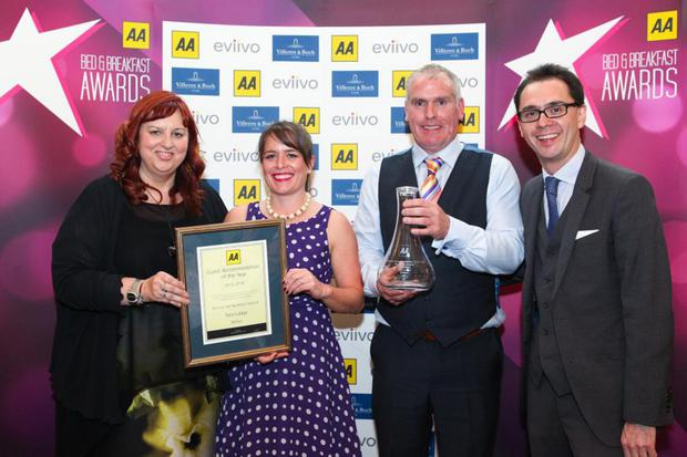 Nora Douds and Connor O'Donnell from Tara Lodge (centre left and right) receive their award from Giovanna Grossi, AA Hotel Services group area manager, and Simon Numphud, head of AA Hotel Services