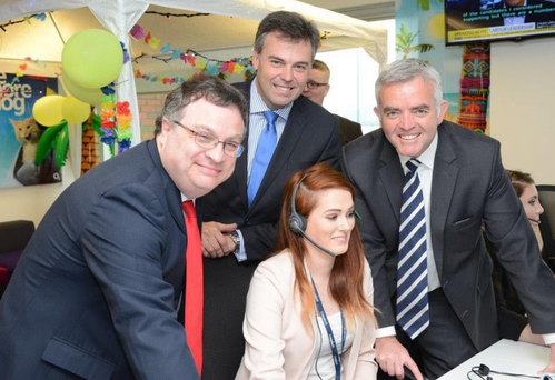 Employment and Learning Minister Stephen Farry (left) and Enterprise, Trade Investment Minister Jonathan Bell (right) mark Convergys' 10th anniversary in Belfast with Invest NI chief executive Alastair Hamilton and staff member Lauren Bratty