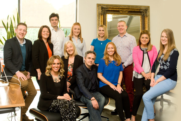 Marketing star: Karen (fourth from right) with her team at shopper marketing company MXB, which is about to double its turnover and its number of staff within the space of a year