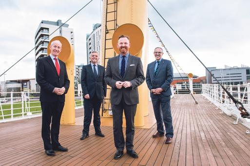 Titanic Belfast's deputy chairman, Conal Harvey, and chief executive, Tim Husbands, with Enterprise, Trade and Investment Minister Jonathan Bell welcome Bernard Donoghue (The Association of Leading Visitor Attractions' Director) on SS Nomadic ELAINE HILL