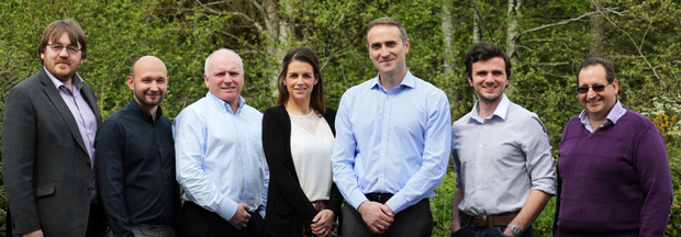 Team Solutionz managing director Geoff Higgins (third from right) with his staff