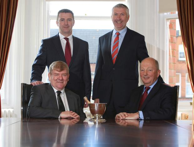 Front row (left to right): Paul Cooper of CPNI with Robert Gordon of Gordons Chemists and (back row) John Clark of Gordons Chemist with Gerard Greene of CPNI