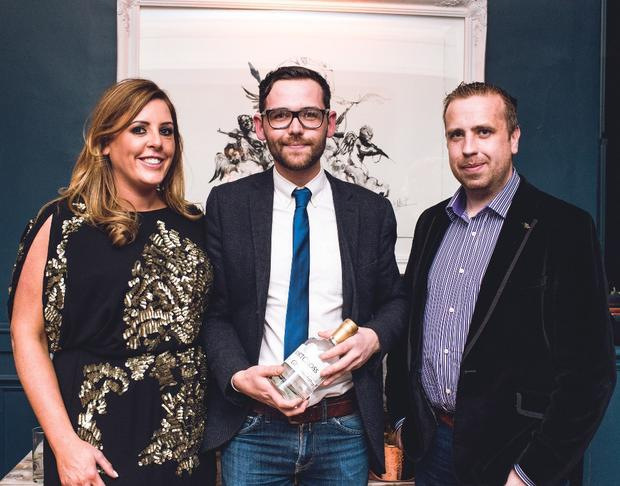Shortcross Gin's Fiona and David Boyd-Armstrong with winner Micheal Brown (centre) from The Merchant Hotel, at the event at Sixty6