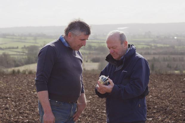 Crumlin farmer Mark Wilson with Gary Hillman, agronomist at White's Oats, with a camera for monitoring the growth of oats
