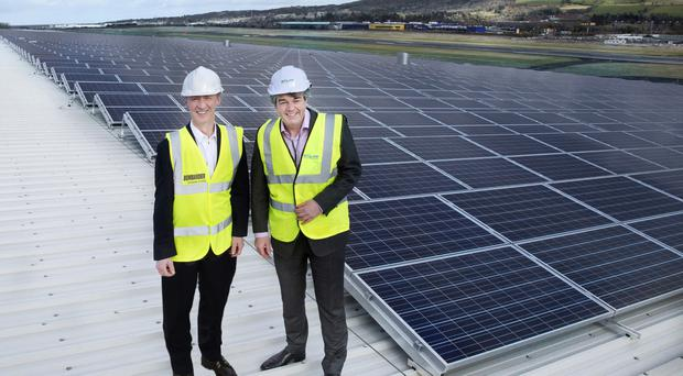 Michael Ryan, vice-president and general manager, Bombardier Belfast (left) and Michael Burke, managing director at SALIIS Renewables, on the rooftop solar installation at Bombardier