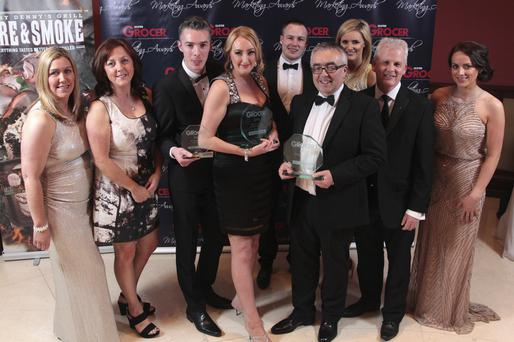 The Henderson Group team celebrate after winning best in-store consumer sales promotion and green retailer of the year at the Ulster Grocer Marketing Awards