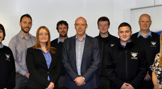 The staff of Diamond Electronic Systems (back from left) Philip Stevenson, Ian Daniel, Gabriel Hill-Lavery and Roger Corbett and (front from left) John O'Connor, Angela Bennett, Stephen Snoddon, Kyle Adams and Julieann Picking