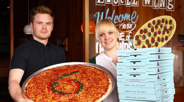 Luke Wolsey, managing director of Little Wing Pizzeria, gets to work with Catherine MacDonald, general manager of Little Wing Enniskillen