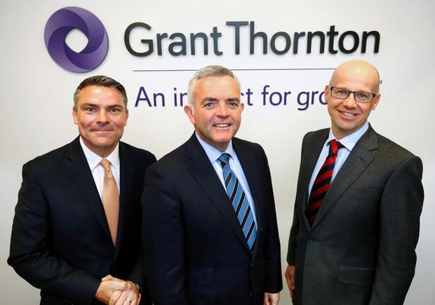Enterprise Minister Jonathan Bell with Mark Cardiff, Head of Audit, Grant Thornton UK LLP and Richard Gillan, Partner in Charge