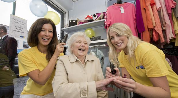 Marie Curie customer Iris Quinn gets pampered by Carol Donnelly and Hannah Palmer who work for BT