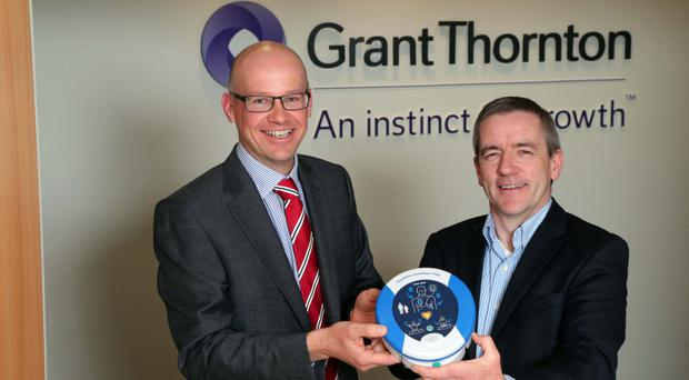 Richard Gillan of Grant Thornton with Declan O'Mahoney, chief executive of HeartSine Technologies