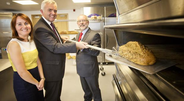Enterprise, Trade and Investment Minister Jonathan Bell (centre) joins Tim and Mairead Andrew from Andrew Ingredients as the firm celebrates its 70th anniversary