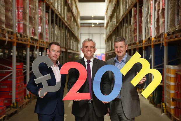 Enterprise, Trade and Investment Minister Jonathan Bell celebrates the investment yesterday with Lidl's Dermot McGirr and Glen Cinnamon