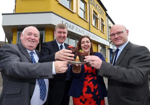 From left, West Belfast MLA Fra McCann joined Social Development Minister Meryvn Storey, Now Group chief executive Maeve Monaghan and West Belfast MP Paul Maskey at the opening of the Loaf social enterprise and cafe