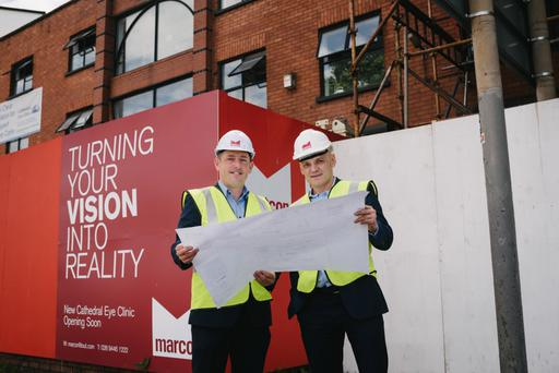 Professor Johnny Moore, clinical director, Cathedral Eye Clinic and Mark O'Connor, director, Marcon Fit-Out with the new Zeiss VisuMax ReLEx equipment at the new clinic in Academy Street, Belfast