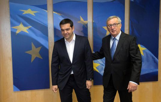 European Commission President Jean-Claude Juncker, right, meets with Greek Prime Minister Alexis Tsipras