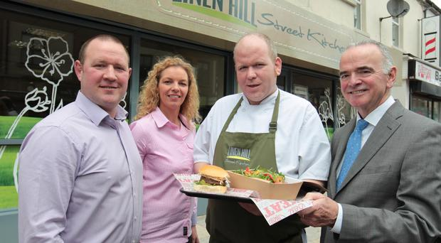 Linen Hill Kitchen and Deli owners John and Fiona Robinson were joined by head chef and partner Shaun Hanna, and Ulster Community Investment chief Harry McDaid, as they opened on Newcastle's Main Street