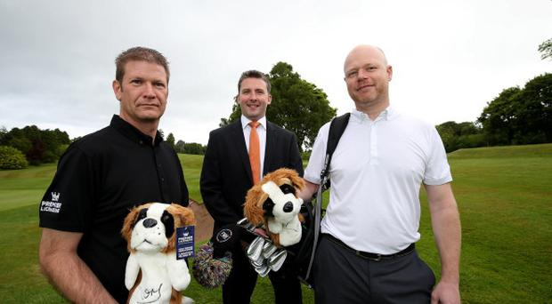 From left, Kevin Funnell and Ross Methven of Premier Licensing, with Mark Canning, senior investment manager at WhiteRock Capital Partners, during a visit to Holywood Golf Club. They are holding some of the Saint Bernard head covers made for Rory McIlroy, who perfected the sport at the Co Down club