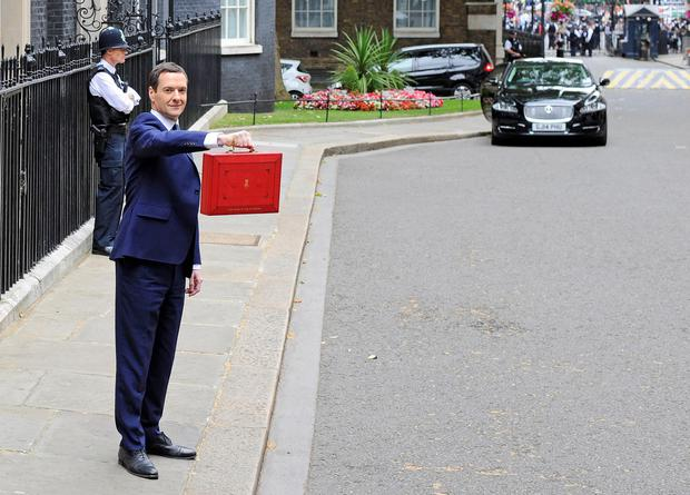 Chancellor Ceorge Osborne outside 11 Downing Street yesterday before outlining his Budget in the Commons
