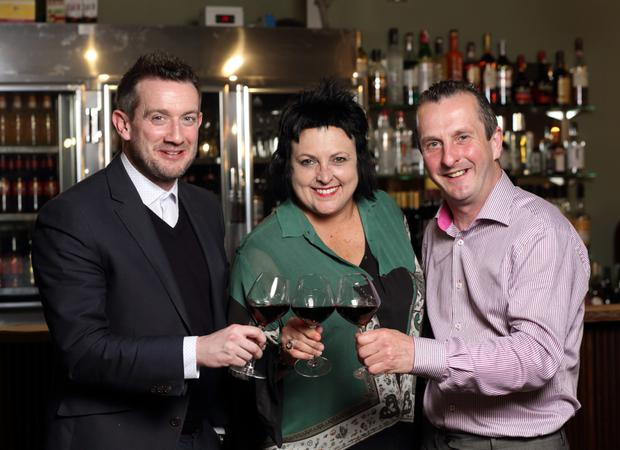 Jonny Callan and Stephen Beckett of Cabroso Wines and Lisa McGuigan celebrate exclusive distribution rights in NI of Lisa McGuigan wines