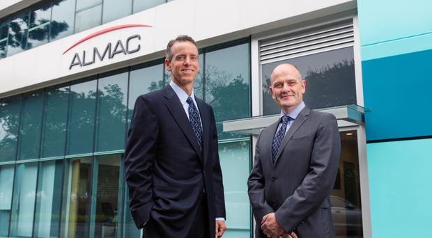 Jim Murphy, managing director of Almac's clinical technologies business unit, and Dr Robert Dunlop, managing director of the firm's clinical services business unit, at Almac's new Asia Pacific headquarters in Singapore