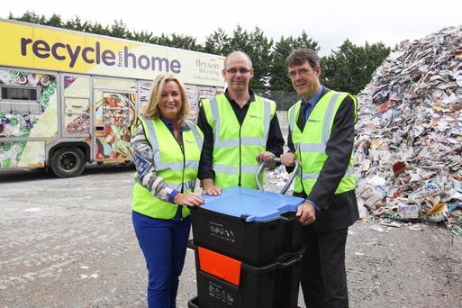 Jo-Anne Dobson MLA, Philip Woolsey, general manager of Huhtamaki, and Eric Randall, director of Bryson Recycling, with the Wheelie Box collection system