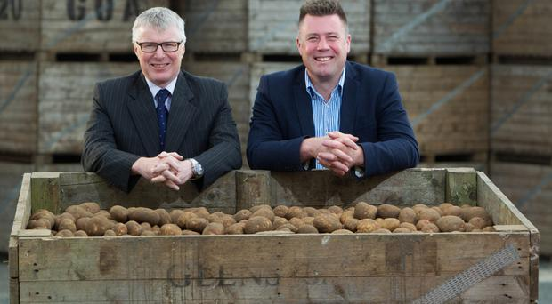 Roger Hamilton (left), business manager at Danske Bank, with Michael McKillop, director of Glens of Antrim Potatoes