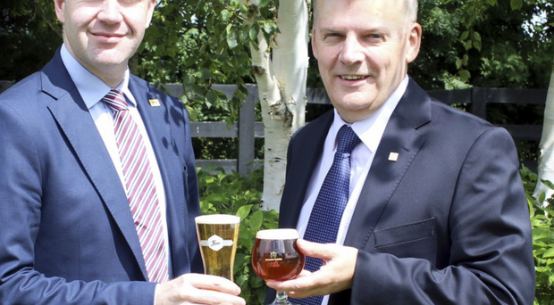 Conor Farrell (left), business development manager at Cumberland Breweries, joined Kevin Tuck, managing director of Alltech Ireland, to toast Alltech's takeover of Cumberland's breweries in Newry and Cumbria. The brewing business was formerly owned by Norbrook, best known for pharmaceuticals