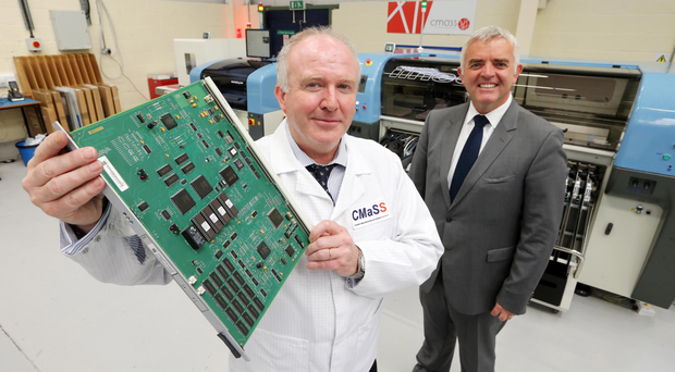 Enterprise, Trade and Investment Minister Jonathan Bell with Barry Mulhern of CMASS Ltd