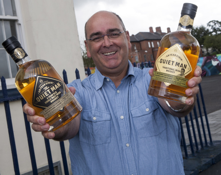 Ciaran Mulgrew at the proposed site of the new Niche Drinks Distillery with An Fear Ciuin or The Quiet Man whiskey