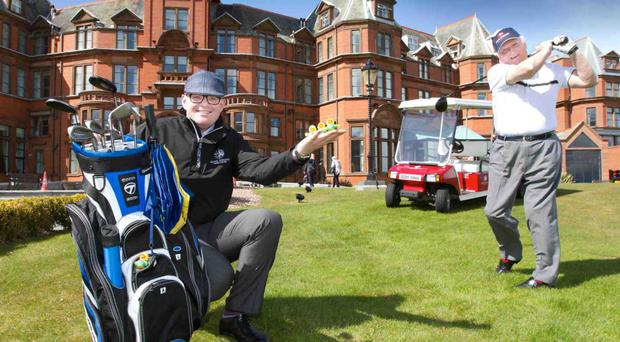 Sir William Hastings of the Hastings Group (right), and Stephen Meldrum, general manager of the Slieve Donard Resort, welcome its listing in a top 10 of Britain's best golf hotels