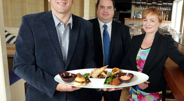 From left, Lewis Waterworth from Harbour & Co, Andy Tew and Tracey Morrow from Ulster Bank officially launch a £750,000 revamp at the restaurant in Donaghadee