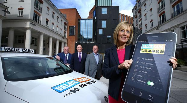 Value Cabs' Christopher McCausland, Visit Belfast chief executive Gerry Lennon, the taxi firm's Stephen McCausland and Anne McMullan, marketing and communications director at Visit Belfast