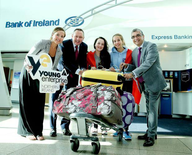 Budding entrepreneurs are representing Northern Ireland at an event in Canada. From left, Gail Hamilton from Young Enterprise and Sean Sheehan, Bank of Ireland, wished Emilie Vose from Bangor and Charlotte Campbell from Coleraine all the best for their voyage, along with Mukesh Sharma from the World Travel Centre