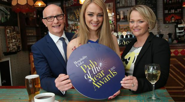 Colin Neill, chief executive of Hospitality Ulster, model Ashleigh Coyle, and Olga Walls, chair of Hospitality Ulster, at the official launch of the 2015 Pub of the Year Awards at the Hudson Bar, Belfast