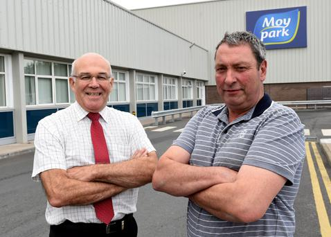 Factory general manager Ronnie Newell with Derek Hazleton (right), who this year celebrated 40 years at Moy Park in Dungannon, Co Tyrone