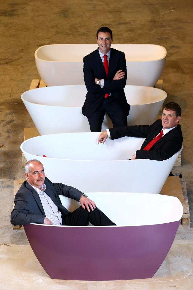 From bottom left, James McCormick of Adamsez with Neil McCabe of WhiteRock Capital Partners (middle) and Ciaran Hunter, director of Adamsez, marking a £400,000 investment in the bathroom business