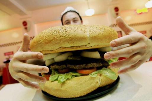 A staff member serves up a burger at a Eddie Rocket's outlet in Dublin